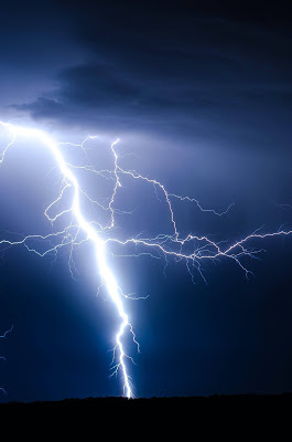 image of powerful lightning bolt in blue sky