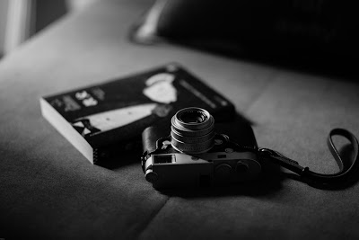 camera on table beside book